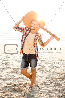 Handsome young man at the beach