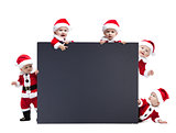 Five Santa Claus baby hold black advertisment banner blank