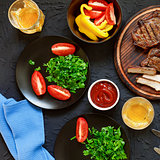 Tasty and juicy steaks, various fresh vegetables,