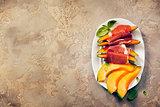 Prosciutto ham with cantaloupe melon. Italian antipasti snack