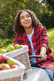 Mixed Race Female Teenager Driving Tractor Picking Apples