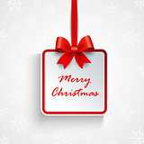 Christmas greeting card with white sign and red ribbon