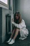 mentally ill girl with straight jacket in a Psychiatric