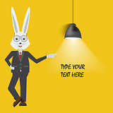 Rabbit teacher showing with empty place for your text or design. Lamp hanging on yellow background.