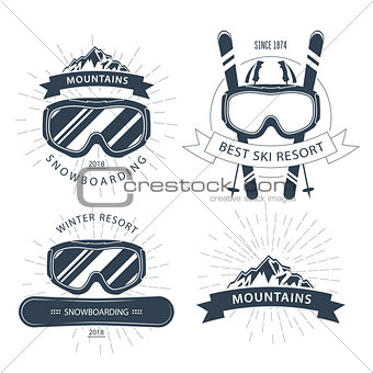 Ski resort emblem and lebels with goggles, mountains - winter sp