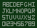 Fabric script on deep green knitted background.
