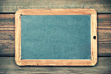 slate blackboard against old wood