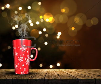 3D mug on a wooden table looking out to a defocussed Christmas t