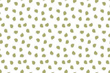 Seamless pattern with green falling leaves. Hand drawn design.
