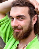 Portrait of a Teenage Boy with Long Hair and Beard.