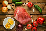 Raw beef with vegetables on wooden boards