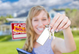 Woman Holding New House Keys with Blank Card In Front of Sold Re
