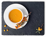 Tea of seabuckthorn on slate stone