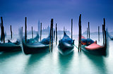 Gondolas on Grand Canal and in the background San Giorgio Maggiore church in Venice Italy