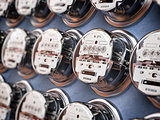 Electric meters in a row measuring power use. Electricity consum