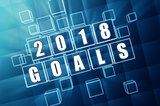 new year 2018 goals in blue glass blocks