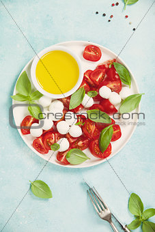 Caprese salad with basil and mozzarella balls