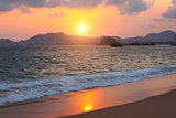 Sunset, ocean waves and beach, Acapulco, Mexico