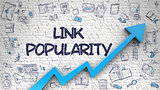 Link Popularity Drawn on White Brick Wall.