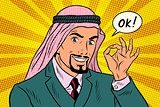 OK gesture Arab businessman
