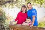 Mixed Race Caucasian and Hispanic Family At The Park.