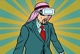 Surprised Arab businessman in VR glasses