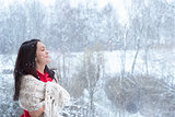 Brunette woman enjoying the snowfall