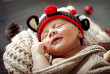 Little baby sleeping in Christmas costume