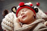 Little baby sleeping in Christmas costume