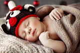 Cute baby sleeping in Christmas pajamas