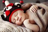 Cute baby sleeping in Christmas pajamas