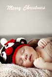 Cute baby sleeping in Christmas costume