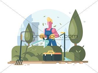 Gardener cuts green bush