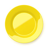 Empty yellow ceramic round plate isolated on white
