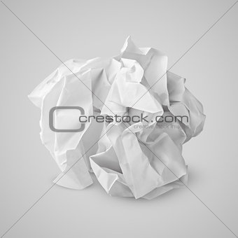Crumpled paper ball on gray