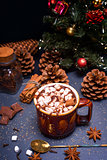 hot chocolate with marshmallow slices in a brown ceramic mug