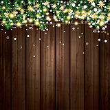 Fir Branch with Neon Lights and Snowflakes on Wooden Background.