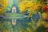 Reflection of a little temple in a pond of the Park of Monza sur