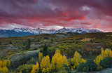 Sun setting over view of San Juan Mountain range and Autumn Fall color of the Dallas Divide Ridgway, Colorado, America