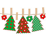 Patchwork with Christmas tree hanging on a rope in cloth pegs