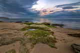 beauty long exposure rocky beach seascape and sea rocks with algae
