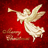 Golden Christmas angel with trumpet.