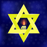 Yellow Star of David and Burning Candles