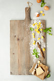 raw italian pasta tortellini on wooden board