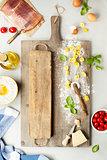 raw italian pasta tortellini on wooden board