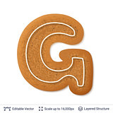 Gingerbread letter G isolated on white.