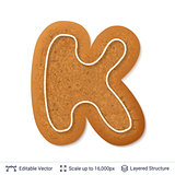 Gingerbread letter K isolated on white.