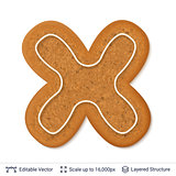 Gingerbread letter X isolated on white.