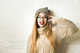 Trendy Hipster Girl in Winter Clothes Going Crazy
