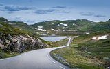 Scenic Norwegian road throgh the lakes and rocks with some snow